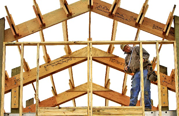Dan Brakebill takes measurements while framing a house Thursday at the Fredonia Mountain Nature Resort off of John Henry Lewis Road in Sequatchie County, Tenn.