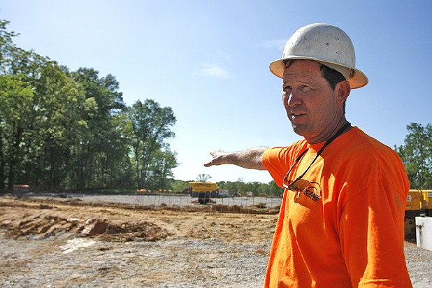 Barry Ward, site superintendent for construction of the Islamic Community of Greater Chattanooga's new Islamic center, points to what will be the entrance of the domed building  Friday.