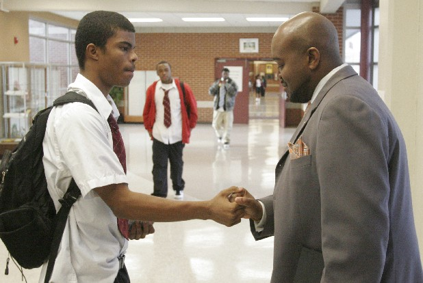 "Howard School of Academics and Technology executive principal Paul Smith, right, shakes hands with Roderick McCauley at the beginning of the school day. This year Smith started a program highlighting ""My GiG"" to reinforce that each student's ""Goal is Graduation.""