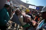 23 miners free as Chile rescue goes off flawlessly