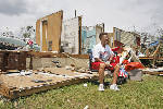 PHOTO GALLERY: Storm cleanup continues