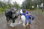 At least 75 rescued from flooding in coastal Mississippi