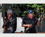 Mexico's vigilantes turn over 11 detained suspects