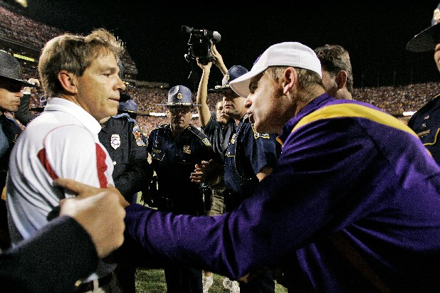 In this Nov. 8, 2008, photo, Alabama coach Nick Saban, left, and LSU coach Les Miles talk after Alabama defeated LSU 27-21 in Baton Rouge, La. No. 3 Alabama faces No. 9 LSU on today. (AP Photo/Tony Gutierrez)