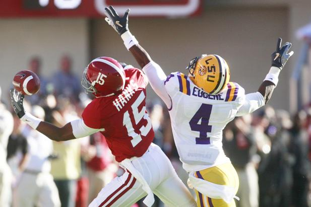 Alabama's Darius Hanks (15) drops a pass as LSU's Jai Eugene (4) defends during the first quarter of an NCAA college football game at Bryant Denny Stadium in Tuscaloosa, Ala., Saturday, Nov. 7, 2009. (AP Photo/Dave Martin)
