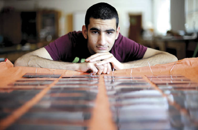 Do it yourself solar panels become classroom project times free press staff photo by allison kwesellchattanooga times free press bashar al gorges 18 is making a solar panel for his senior project at at east ridge high solutioingenieria Image collections