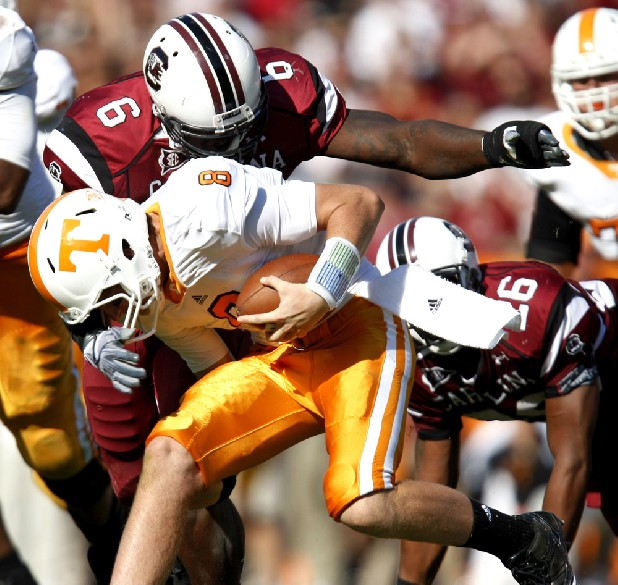 South Carolina defensive tackle Melvin Ingram (6) catches Tennessee quarterback Tyler Bray (8) for a sack after he was first hit by South Carolina safety Antonio Allen (26), right, during the fourth quarter in an NCAA college football game at Williams Brice Stadium on Saturday, Oct. 30, 2010, in Columbia, SC.  (AP Photo/Rich Glickstein)