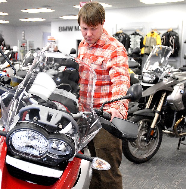Ryan Cooke looks at BMW motorcycles at Pandora's European Motorsports. He came to the store looking to buy a dual-sport motorcycle.