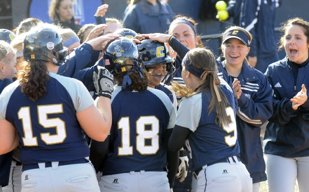The UTC sofball team celebrates with first baseman Kasey Tydingco, center, after she hit the game winning home run in UTCs 13-4 win at the Frost Classic Friday at Frost Stadium.  Staff Photo by Tim Barber