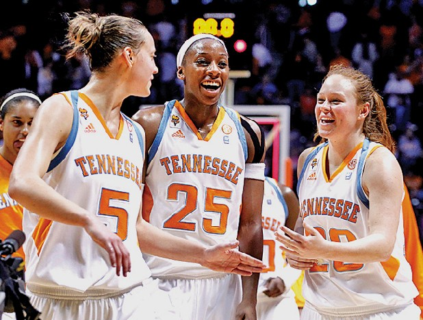 Tennessee's Angie Bjorklund (5), Glory Johnson (25) and Sydney Smallbone (20) celebrate the team's 80-60 victory over LSU in an NCAA college basketball game Sunday in Knoxville. (AP Photo/Wade Payne)