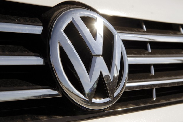 The VW logo is seen on the front of one of dozens of new Passats made at the Chattanooga Volkswagen assembly plant parked outside the plant. These cars will be used as demos for testing, internal quality control and press test drives.