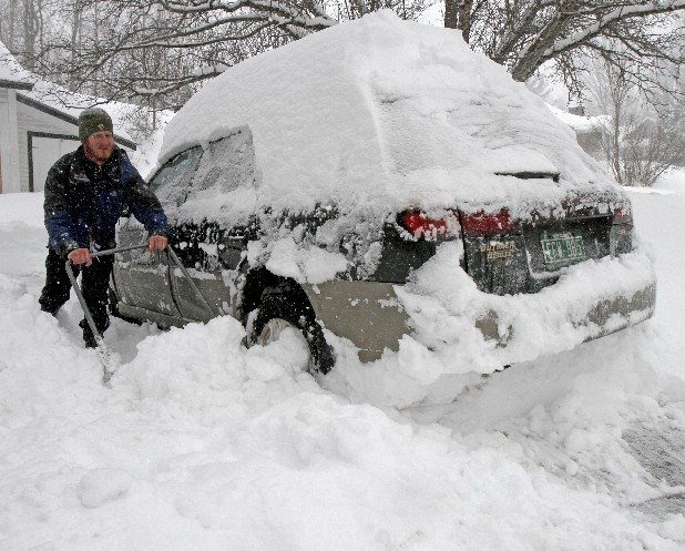 Dave Jacobs tries to shovel out his car so he could head to Mad River ski area on Monday, March 7, 2011 in Montpelier, Vt. The National Weather Service says the winter storm that's whacking northern Vermont is going to be one for the record books. Meteorologist Bruce Taber says 20.6 inches of snow has fallen at the Burlington International Airport and it's supposed to keep snowing through the early afternoon. He says some parts of northern Vermont could get up to 30 inches of snow. (AP Photo/Toby Talbot)