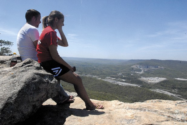Hikers take a break to enjoy the view at Sunset Rock atop Lookout Mountain.
