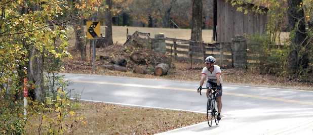 A cyclist speeds through a scenic route on top of Signal Mountain. Staff File Photo by Allison Carter