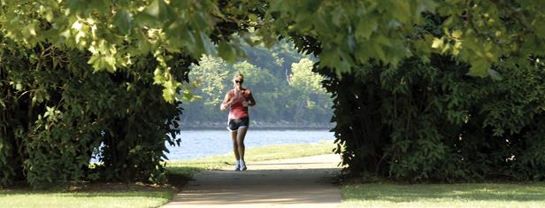 Sarah Moody passes through a tunnel of trees as she runs at the Tennessee Riverpark. The trailhead is at Ross's Landing downtown. Staff File Photo by Tim Barber