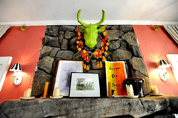 A green bull head hangs above the mantle in the main sitting room of Billy and Jane Pritchard's home on Lookout Mountain.