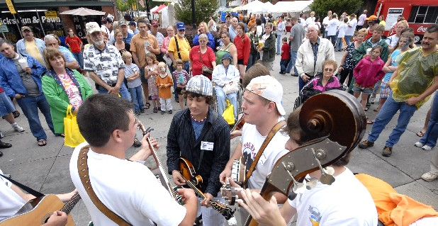 The Mountain Cove Blue Grass band jams at the National Cornbread Festival in downtown South Pittsburg, Tenn. This year's festival is April 30-May 1. Staff File Photo by Tim Barber