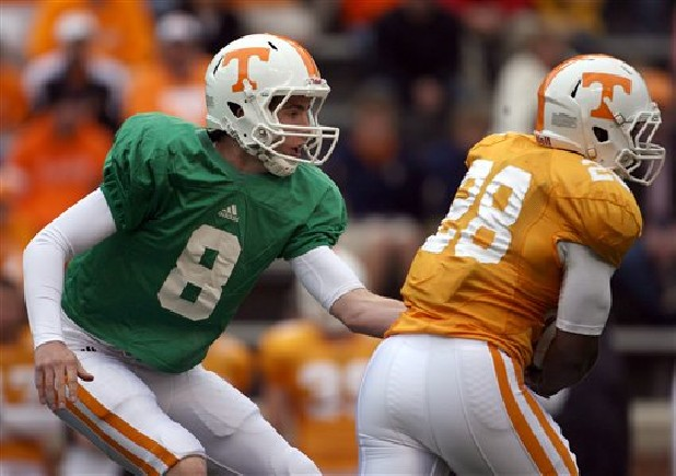 Tennessee quarterback Tyler Bray (8) hands the ball off to tailback Tauren Poole (28) during the Orange and White spring NCAA college football game at Neyland Stadium Saturday, April 16, 2011 in Knoxville, Tenn. (AP Photo/The Knoxville News Sentinel, Adam Brimer)