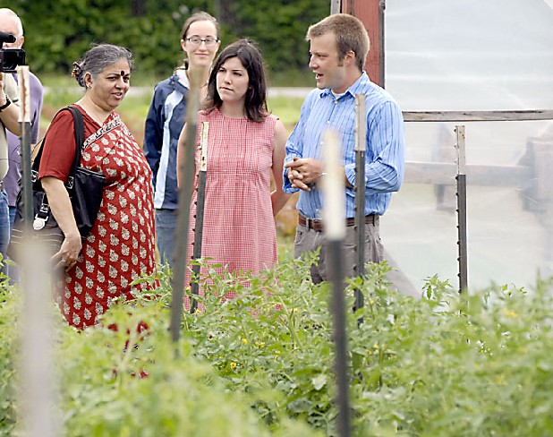 "Dr. Vandana Shiva, left, tours Crabtree Farms on Tuesday with Executive Director Joel Houser, right, and Melanie Mayo, director of outreach and education. Standing behind them is Crabtree Farms intern Andrea Jaeger. Shiva, an advocate for ""a clean and just food system,"" is making a three-day visit to the Chattanooga area. 
