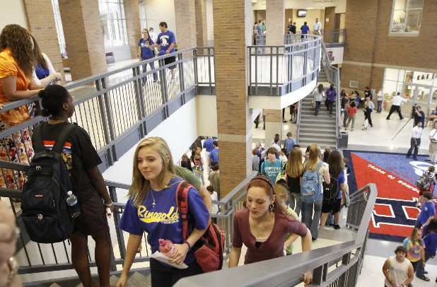 Ringgold High School students make their way upstairs at Heritage High School as Catoosa County students return to class Monday sharing Heritage after a tornado severely damaged Ringgold High last month. Heritage High students will attend half-day classes in the morning and Ringgold will be in class in the afternoons. 