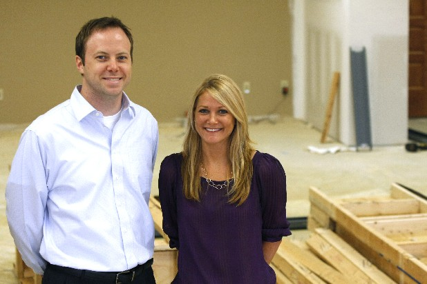 David Paschall, left, senior vice president of finance, and Rebekah Elkins, senior vice president of operations, are two key people in the new office space expansion area for TractManager Inc. The expansion is not yet complete. 