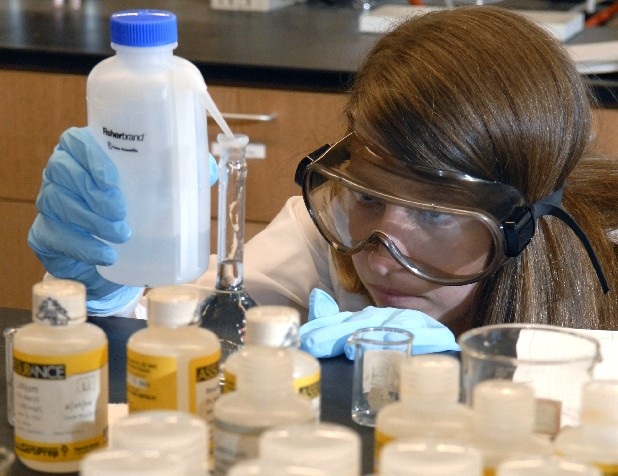 Katie Thurman, a senior chemistry student at UTC, performs experiments in the lab at Grote Hall as she does research about the effects of growing plants in cigarette-butt saturated soil. 
