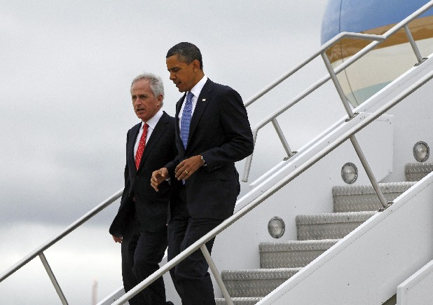 President Barack Obama steps off Air Force One with Sen. Bob Corker, R-Tenn., in Memphis on Monday. Corker said the debt crisis underscores the need for Congress to be put into a fiscal straightjacket like the CAP Act he is sponsoring in the Senate. (AP Photo/Charles Dharapak)