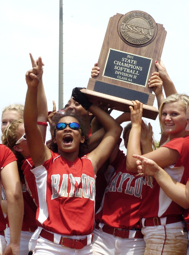 The Lady Red Raiders celebrate after receiveing the TSSAA state championship trophy Saturday. Baylor defeated GPS for the Division II AA state softball championship at Murfreesboro's Starplex.