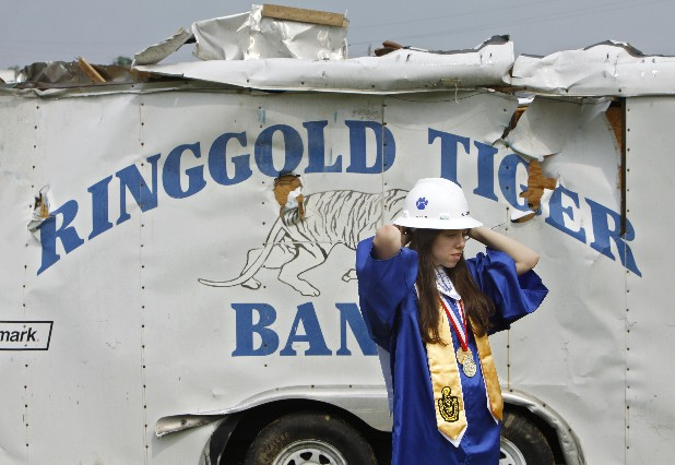 Ringgold High School valedictorian and band member Brianna Gibson stands in front of a trailer at her alma mater that was damaged severely by last month's tornado outbreak.