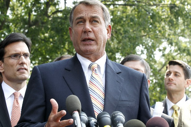 House Speaker John Boehner of Ohio, center, stands with, from left, House Majority Leader Eric Cantor of Va., left, and House Budget Committee Chairman Paul Ryan, R-Wis., as he speaks to reporters outside the White House in Washington on Wednesday after their meeting with President Barack Obama regarding the debt ceiling. (AP Photo/Charles Dharapak)