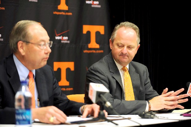 University of Tennessee Athletic Director Mike Hamilton, right, announces his resignation along side Chancellor Jimmy Cheek on Tuesday at Neyland Stadium. His departure comes in the wake of an NCAA investigation into alleged wrongdoing by UT athletics. Hamilton, who succeeded Doug Dickey as men's athletic director on July 1, 2003, will receive a $1.335 million buyout over the next 36 months.