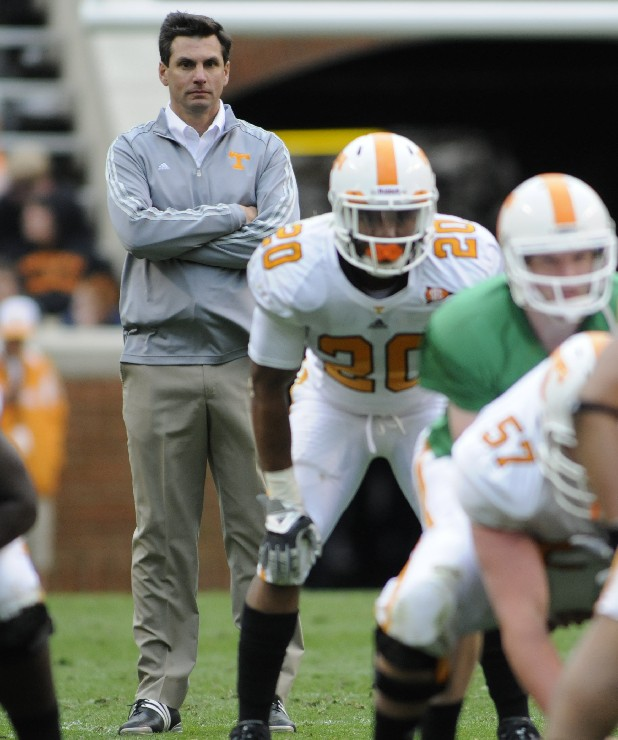UT coach Derek Dooley watches his team during the Orange and White game at Neyland Stadium in April.