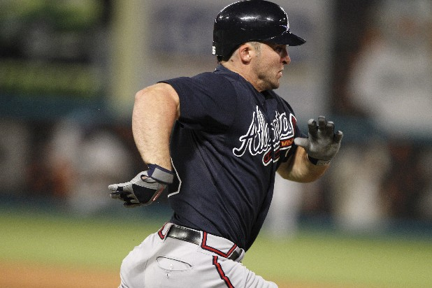 Atlanta Braves' Dan Uggla  runs to first before being thrown out during a baseball game against the Florida Marlins in Miami, Tuesday, June 7, 2011. (AP Photo/Lynne Sladky)