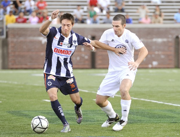 Chattanooga Football Club's Mark Beattie, No. 6,  attempts to take possession of the ball from C.F. Monterrey's Alejandro Ruiz, No. 36, during the CFC vs. C.F. Monterrey game Monday evening at Finley Stadium in Chattanooga, Tenn.