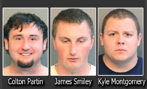 These men were charged with civil rights intimidation on 7/10/11 James Smiley, 27, and Kyle Montgomery, 21, Colton Partin, 21.