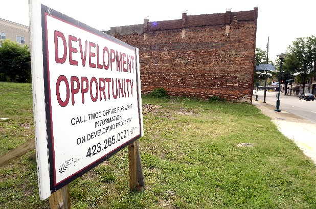 Multiple vacant lots are photographed Wednesday in the 400 block of MLK Blvd., leading up to the former Renewal Barber Shop at 423 MLK Blvd., seen in the background.
