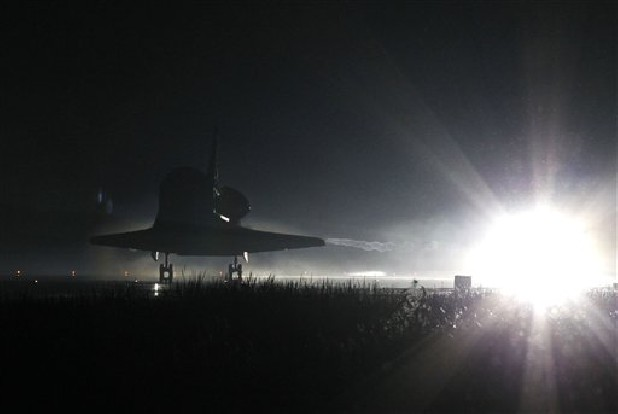 Space Shuttle Atlantis lands at the Kennedy Space Center at Cape Canaveral, Fla. Thursday, July 21, 2011. The landing of Atlantis marks the end of NASA's 30 year space shuttle program. (AP Photo/Terry Renna)