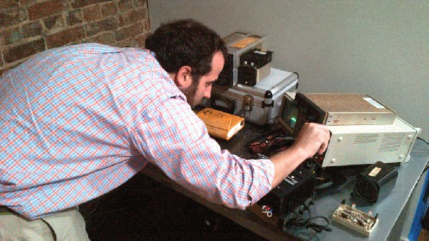 Richard Hardin, founder of Cumberland Signal Labs, tweaks an instrument at his Main Street office in Chattanooga. His invention, which he