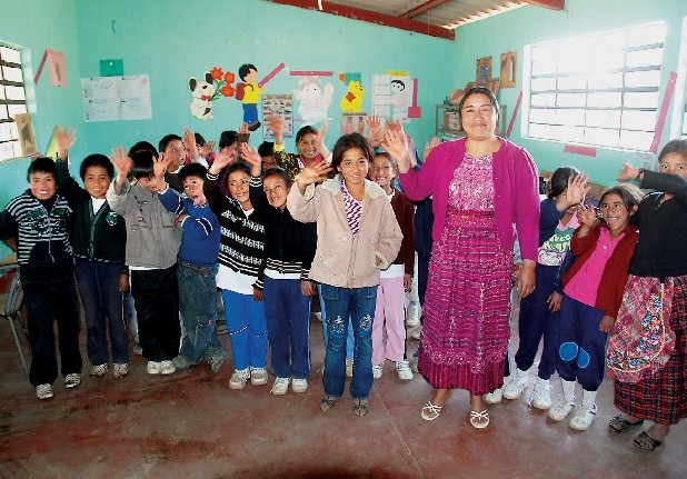 The fourth-grade class at a rural school in Totonicapán, Guatemala, poses for a picture. Jennifer Xiloj, 10, in the middle, was born in Chattanooga but moved to Guatemala last year.