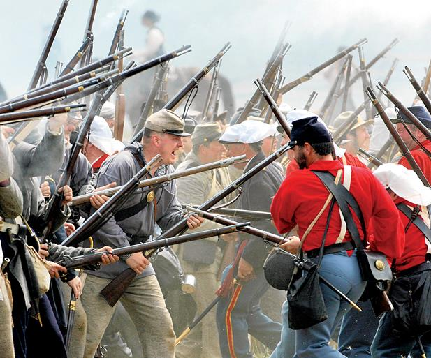 Civil War re-enactors perform at a re-enactment of the First Battle of Bull Run in Manassas, Va. (Associated Press)