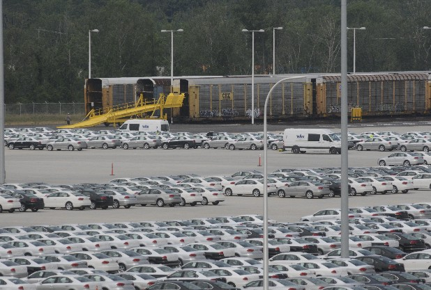 Train cars sit near a lot at the Volkswagen plant at Enterprise South industrial park.