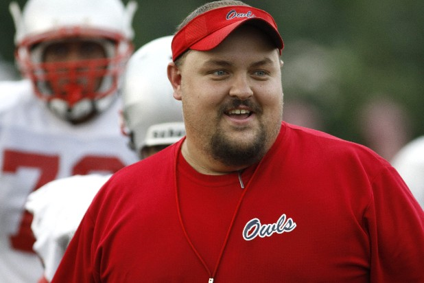 Ooltewah High School's new head coach Shannon Williams runs drills with his team on the school practice field.