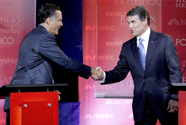 Republican presidential candidates former Massachusetts Gov, Mitt Romney, left, and Texas Gov. Rick Perry shake hands at the finish of a Republican presidential candidate debate at the Reagan Library on Wednesday.