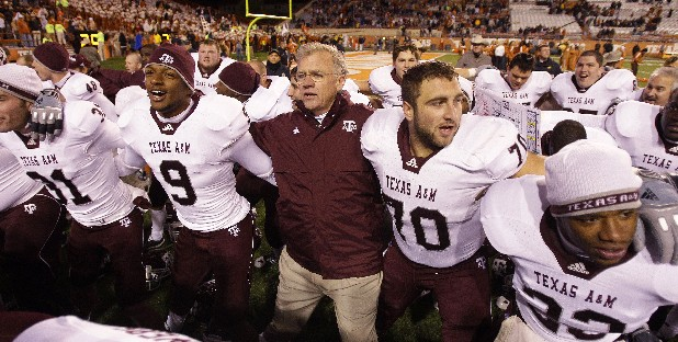 In this Nov. 25, 2010, file photo, Texas A&M coach Mike Sherman, center, sings school songs as he celebrates with his players after defeating Texas in an NCAA college football game, in Austin, Texas. The Southeastern Conference cleared the way for Texas A&M to join its ranks in an announcement Wednesday, Sept. 7, 2011, but with one snag. A Big 12 school has threatened to sue if the Aggies leave the fold. (AP Photo/Eric Gay, File)