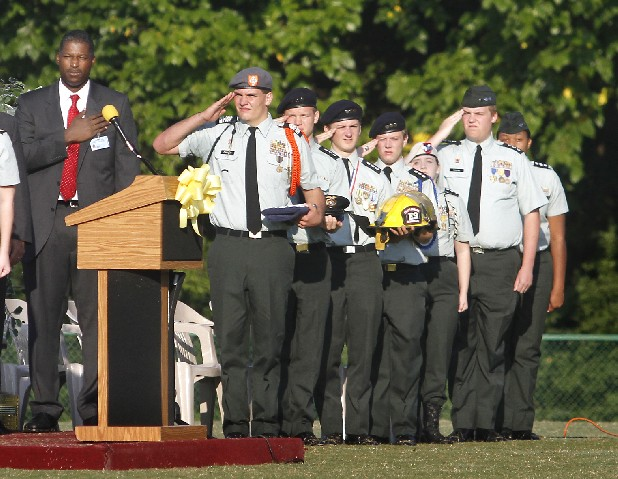 Principal Zacery Brown and members of the East Ridge High School JROTC salute as the American flag is raised Friday. The Junior Reserve Officer Training Corps at East Ridge High School hosted a Sept. 11 memorial on the school's football field Friday morning. Former U.S. Rep. Zach Wamp and East Ridge's Mayor Brent Lambert spoke during the memorial.