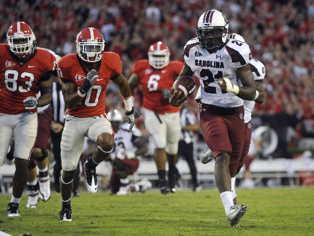 South Carolina running back Marcus Lattimore (21) runs for a touchdown.  (AP Photo/John Amis)