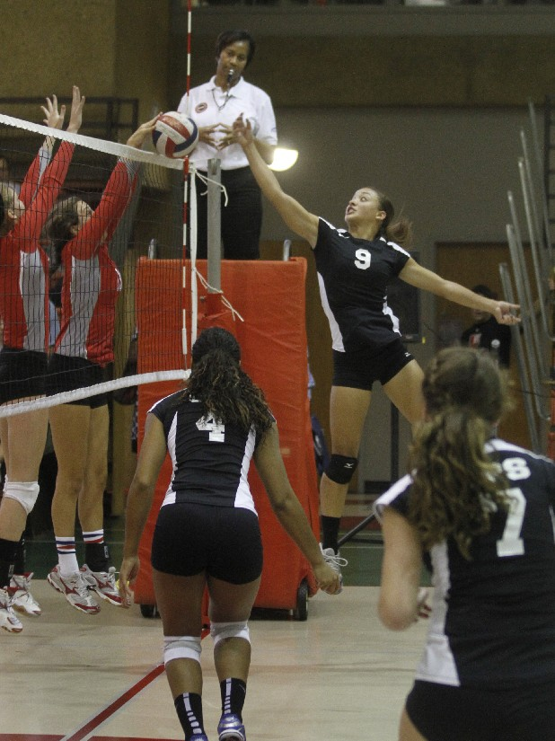 GPS's Tory Kemp, right, stretches to tip the ball over the net during Tuesday's match against Baylor.
