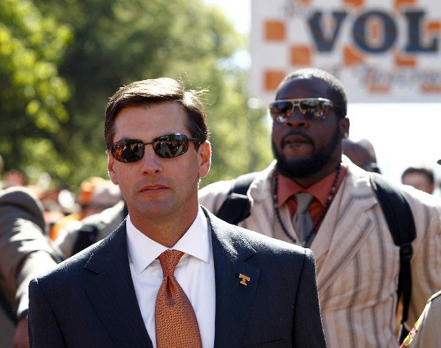 Tennessee coach Derek Dooley makes his way through fans  during the traditional Vol Walk before an NCAA football game against Tennessee-Martin at Neyland Stadium Saturday, Sept. 4, 2010 in Knoxville, Tenn. (AP Photo/Wade Payne)