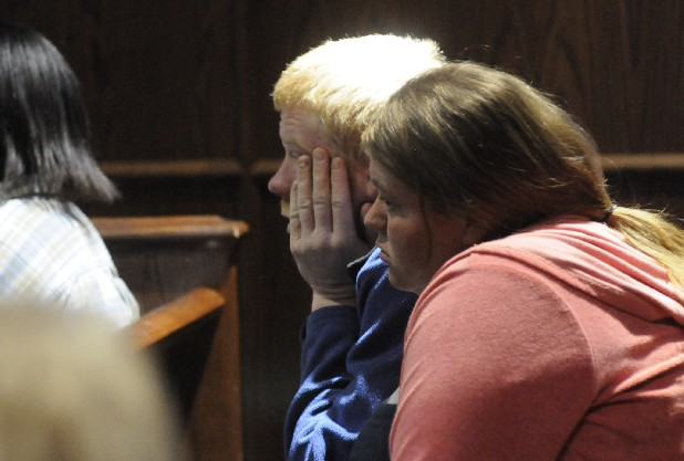 Thomas and Samantha Wallace await their bond hearing Monday in Judge Rebecca Stern's courtroom. Their bond did not change and they remained free. They are charged with criminally negligent homicide in the shooting death of their 2-year-old daughter.