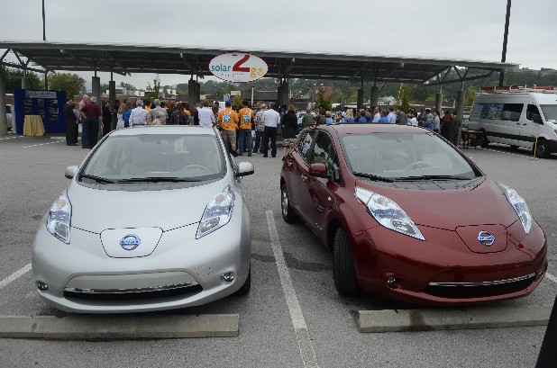 Nissan Leaf electric vehicles are parked at a Thursday morning event at 2 North Shore where five charging stations for electric vehicles and a parking area underneath a solar photovoltaic array were introduced to the public.
